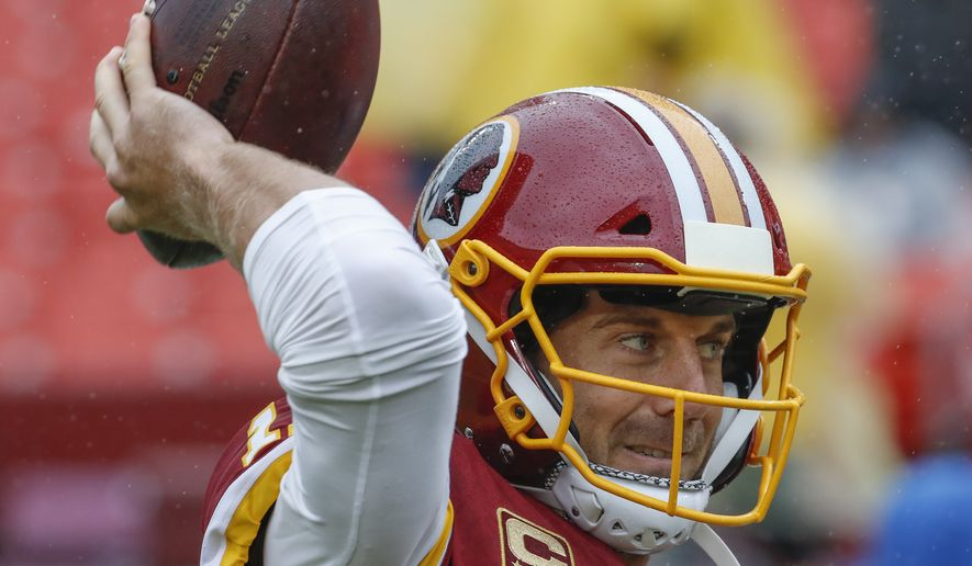 Washington Redskins quarterback Alex Smith (11) warms up before the NFL football game against the Green Bay Packers, Sunday, Sept. 23, 2018 in Landover, MD. (AP Photo/Alex Brandon)
