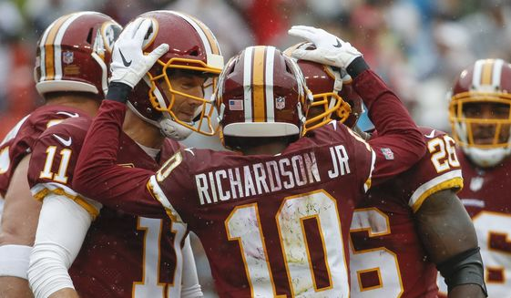 Washington Redskins wide receiver Paul Richardson (10) celebrates his touchdown with quarterback Alex Smith (11) and running back Adrian Peterson (26) during the first half of an NFL football game against the Green Bay Packers, Sunday, Sept. 23, 2018, in Landover, Md. (AP Photo/Alex Brandon)