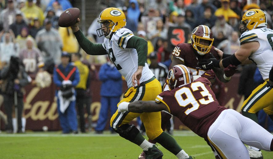 ae2c848eb Green Bay Packers quarterback Aaron Rodgers (center) runs the ball against  Washington Redskins defensive