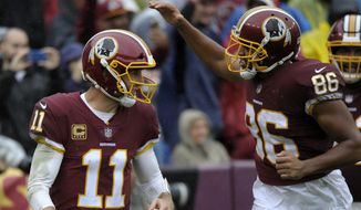 Washington Redskins quarterback Alex Smith (left) and tight end Jordan Reed (right) celebrate a touchdown during an NFL football game against the Green Bay Packers, Sunday, Sept. 23, 2018, in Landover, Md. (AP Photo/Mark Tenally)