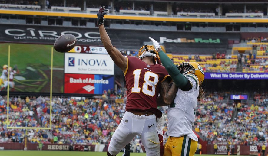 Green Bay Packers defensive back Davon House, right, breaks up a pass intended for Washington Redskins wide receiver Josh Doctson (18) during the first half of an NFL football game , Sunday, Sept. 23, 2018 in Landover, Md. (AP Photo/Carolyn Kaster) **FILE**