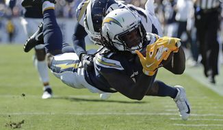 Los Angeles Chargers wide receiver Mike Williams scores in front of Los Angeles Rams defensive back Lamarcus Joyner during the second half in an NFL football game Sunday, Sept. 23, 2018, in Los Angeles. (AP Photo/Jae C. Hong)