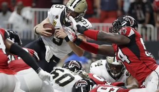 New Orleans Saints quarterback Drew Brees (9) leaps over the goal line for a touchdown against the Atlanta Falcons during overtime of an NFL football game, Sunday, Sept. 23, 2018, in Atlanta. The New Orleans Saints won 43-37. (AP Photo/Mark Humphrey)