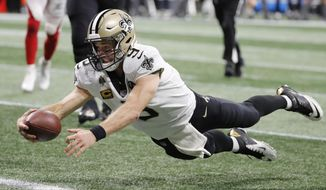 New Orleans Saints quarterback Drew Brees (9) dives into the end zone for a touchdown against the Atlanta Falcons during the second half of an NFL football game, Sunday, Sept. 23, 2018, in Atlanta. The New Orleans Saints won 43-37 in overtime. (AP Photo/David Goldman)