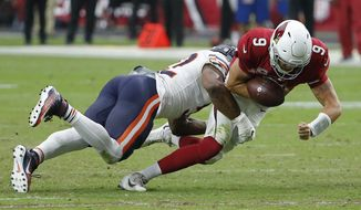 Chicago Bears linebacker Khalil Mack, left, forces fumble on Arizona Cardinals quarterback Sam Bradford (9) during the second half of an NFL football game, Sunday, Sept. 23, 2018, in Glendale, Ariz. The Bears recovered the fumble and defeated the Cardinals 16-14. (AP Photo/Rick Scuteri)