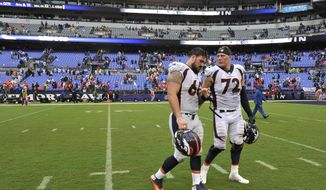 Denver Broncos offensive guard Connor McGovern, left, and offensive tackle Garett Bolles walk off the field after an NFL football game against the Baltimore Ravens, Sunday, Sept. 23, 2018, in Baltimore. (AP Photo/Gail Burton)