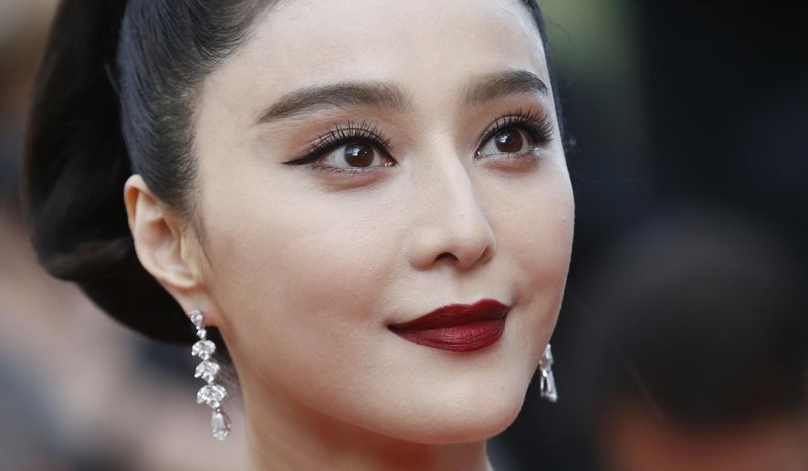 In this May 24, 2017, file photo, Fan Bingbing poses for photographers as she arrives for the screening of the film The Beguiled at the 70th international film festival, Cannes, southern France. Fan Bingbing, one of China's best-known starlets and a rising Hollywood star, has well and truly fallen off the map amid vague allegations of tax shenanigans and possibly other infractions that have put her at odds with China's Communist Party-appointed culture czars. (AP Photo/Alastair Grant, File)