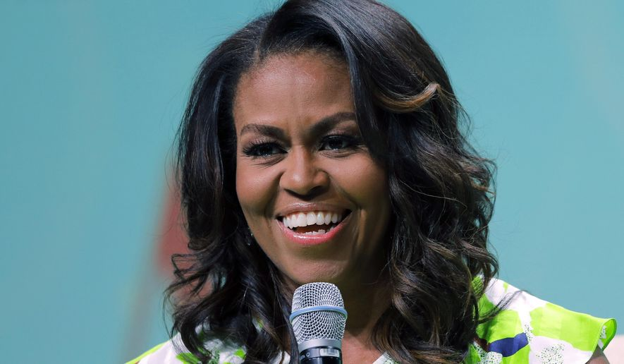 FILE - In this June 22, 2018, file photo, former first lady Michelle Obama speaks at the American Library Association annual conference in New Orleans. Obama is set to appear in Las Vegas on Sunday, Sept. 23, to rally voter registration volunteers and encourage people to vote in the November elections. (AP Photo/Gerald Herbert, File)