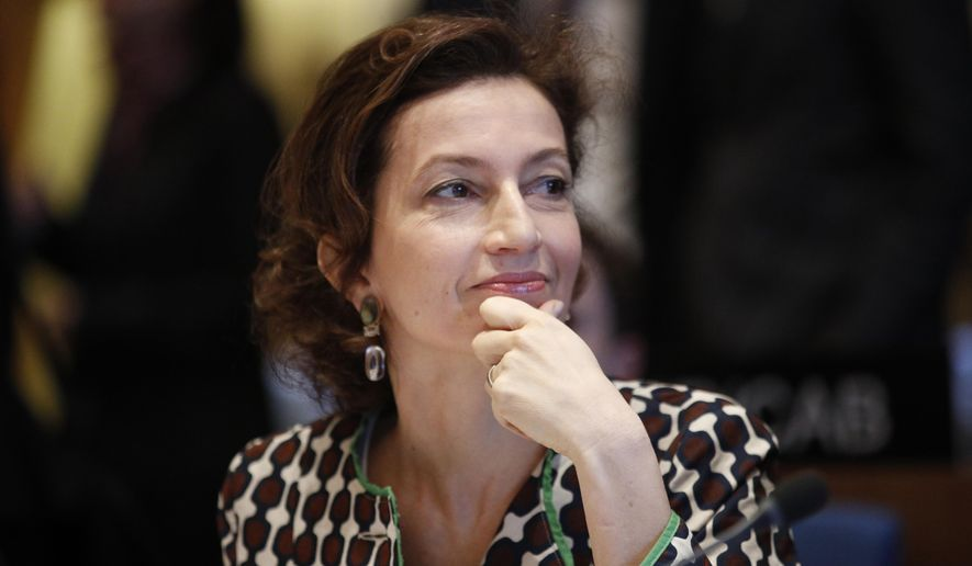 FILE - In a Monday April 9, 2018 file photo, UNESCO Director General France's Audrey Azoulay attends the UNESCO executive council in Paris, before delivering her first speech to the executive council since she has been elected as head of the United Nations Educational, Scientific and Cultural Organization in Nov. 2017. (AP Photo/Francois Mori, File)