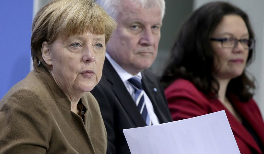 FILE -- In this Thursday, April 14, 2016 photo, from left, German Chancellor Angela Merkel, Horst Seehofer, Chairman of the German Christian Social Union and Andrea Nahles, Chairwomen of the German Social Democrats, address the media during a press conference in Berlin. The leaders of German Chancellor Angela Merkel's governing coalition were trying Sunday to resolve a standoff over the future of the country's domestic intelligence chief and stabilize their six-month-old alliance. (AP Photo/Michael Sohn)