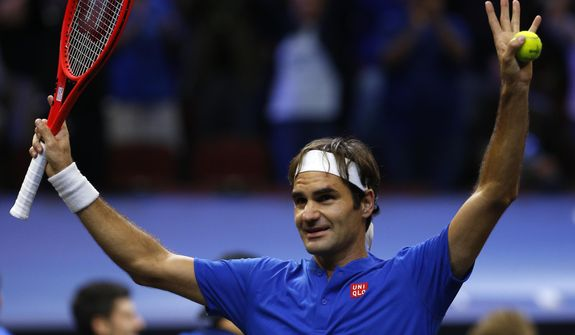 Team Europe's Roger Federer celebrates a men's singles tennis match win against Team World's John Isner at the Laver Cup, Sunday, Sept. 23, 2018, in Chicago. (AP Photo/Jim Young)