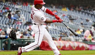 Washington Nationals' Victor Robles hits a solo home run to tie a baseball game during the third inning against the New York Mets at Nationals Park, Sunday, Sept. 23, 2018, in Washington. (AP Photo/Andrew Harnik)