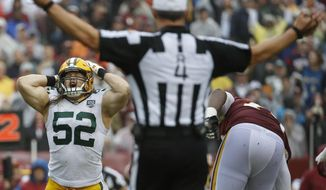 Green Bay Packers linebacker Clay Matthews (52) reacts to his penalty after tackling Washington Redskins quarterback Alex Smith during the second half of an NFL football game, Sunday, Sept. 23, 2018, in Landover, Md. (AP Photo/Alex Brandon)