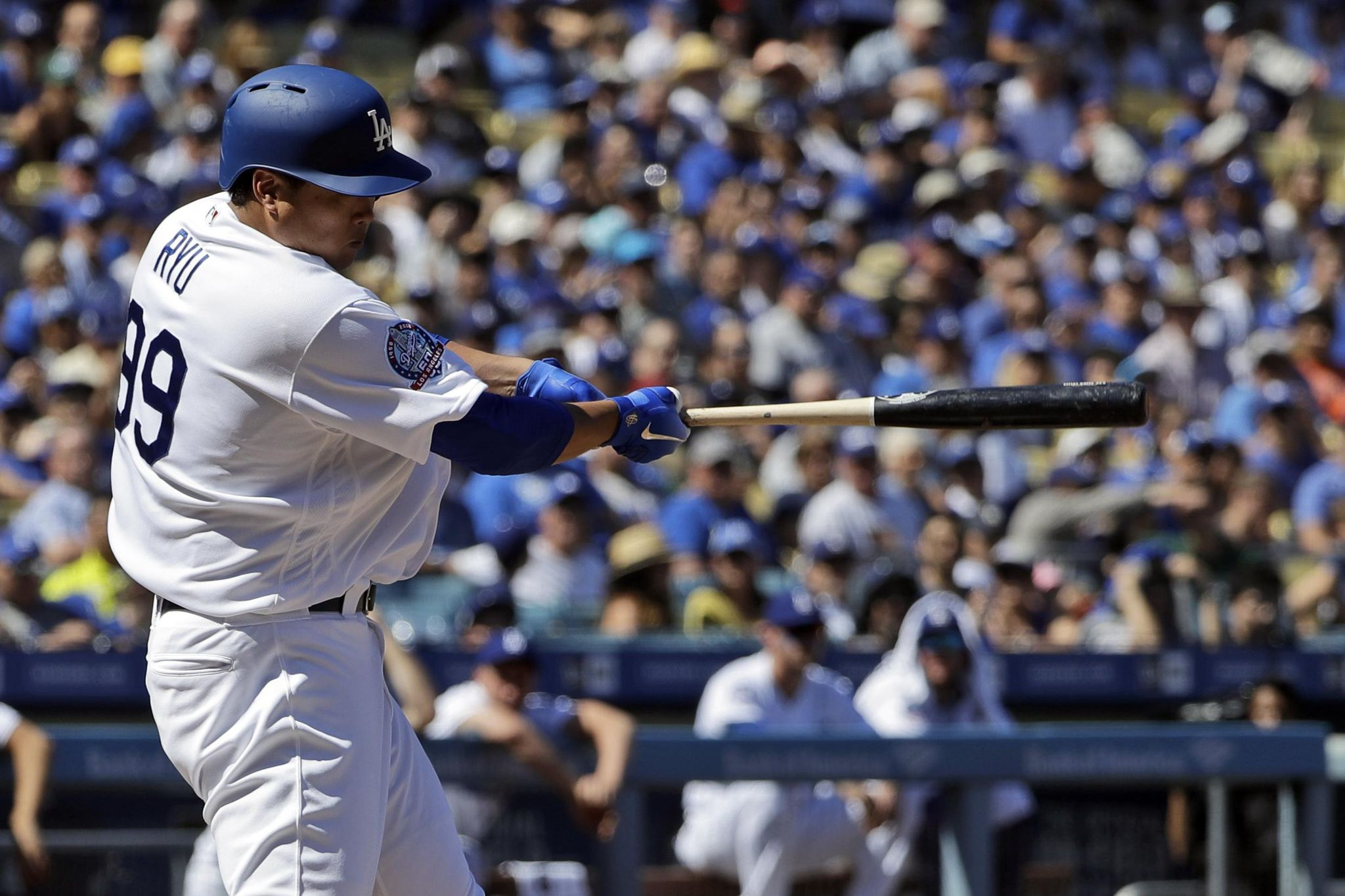 Ryu has 3 of Dodgers' 16 hits in 14-0 rout of Padr...