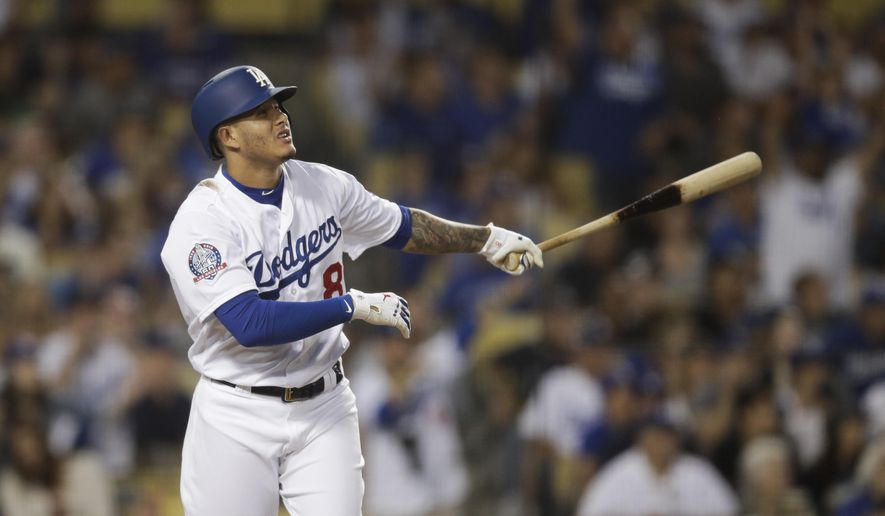 119ec7ea88c Los Angeles Dodgers  Manny Machado watches the flight of his three-run home  run during the third inning of a baseball game against the San Diego  Padres