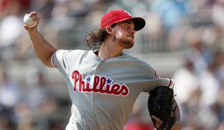 Philadelphia Phillies starting pitcher Aaron Nola works in the first inning against the Atlanta Braves in a baseball game Sunday, Sept. 23, 2018, in Atlanta. (AP Photo/John Bazemore)