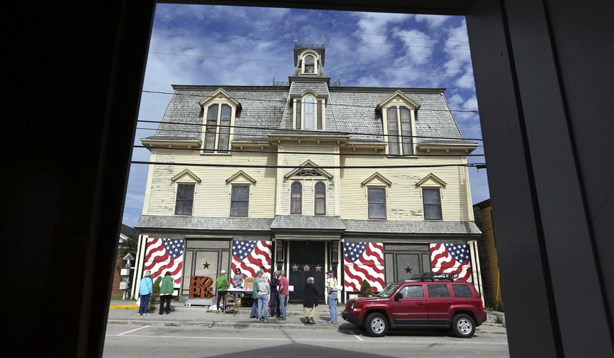 "FILE - In this Sept. 13, 2014, file photo, fans gather outside ""Star of Hope"" the residence of artist Robert Indiana on Vinalhaven Island, Maine. Indiana died on May 19, 2018, in the house, which had a hole in the roof and pigeons living inside. But testimony in probate court showed that he had plenty of money even as his home fell into disrepair around him. (AP Photo/Robert F. Bukaty, File)"
