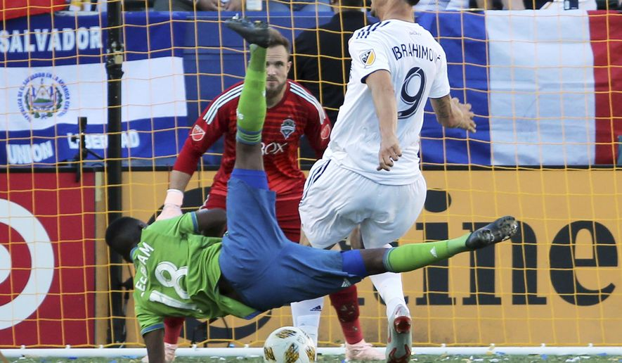 LA Galaxy forward Zlatan Ibrahimovic (9) and Seattle Sounders defender Kelvin Leerdam (18) tangle in front of Seattle goalkeeper Stefan Frei (24) in the first half of an MLS soccer match in Carson, Calif., Sunday, Sept. 23, 2018. (AP Photo/Reed Saxon)