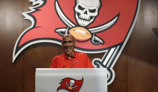 FILE - In this Aug. 14, 2018, file photo, former Tampa Bay Buccaneers head coach Tony Dungy speaks during a Buccaneers NFL football Ring of Honor news conference in Tampa, Fla. Dungy will always be appreciative of the opportunity the Buccaneers provided when no other NFL team was willing to take a chance on him as a head coach. So long after transforming the Bucs from laughingstocks into championship contenders, only to be dismissed a year before the franchise won its only Super Bowl, the Hall of Famer is graciously returning to Raymond James Stadium to become the latest member of the club's Ring of Honor on Monday, Sept. 24. (AP Photo/Chris O'Meara, File)