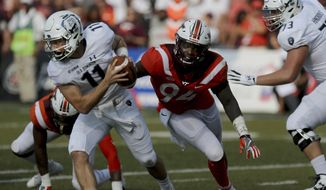 Old Dominion quarterback Blake LaRussa is flushed out of the pocket by Virginia Tech's Trevon Hill during the second half of an NCAA college football game, Saturday, Sept. 22, 2018, in Norfolk, Va. Old Dominion won 49-35. (AP Photo/Jason Hirschfeld) **FILE**