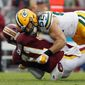 Washington Redskins quarterback Alex Smith was sacked by Green Bay Packers linebacker Clay Matthews on Sunday. Matthews was called for a roughing-the-passer penalty on the play. (ASSOCIATED PRESS)