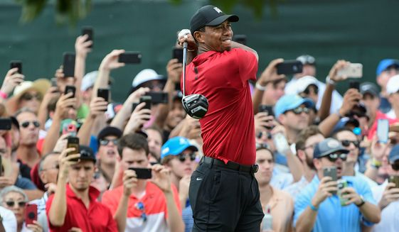 Tiger Woods hits from the third tee during the final round of the Tour Championship golf tournament Sunday, Sept. 23, 2018, in Atlanta. (AP Photo/John Amis) **FILE**
