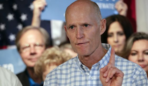 """In this Sept. 6, 2018, file photo, Florida Gov. Rick Scott speaks to supporters at Republican rally in Orlando, Fla. Top Florida Republicans including Scott have been quick to say President Donald Trump is wrong about the death toll in Puerto Rico. Scott said he disagreed with the president and that he has seen the """"devastation firsthand."""" (AP Photo/John Raoux) **FILE**"""