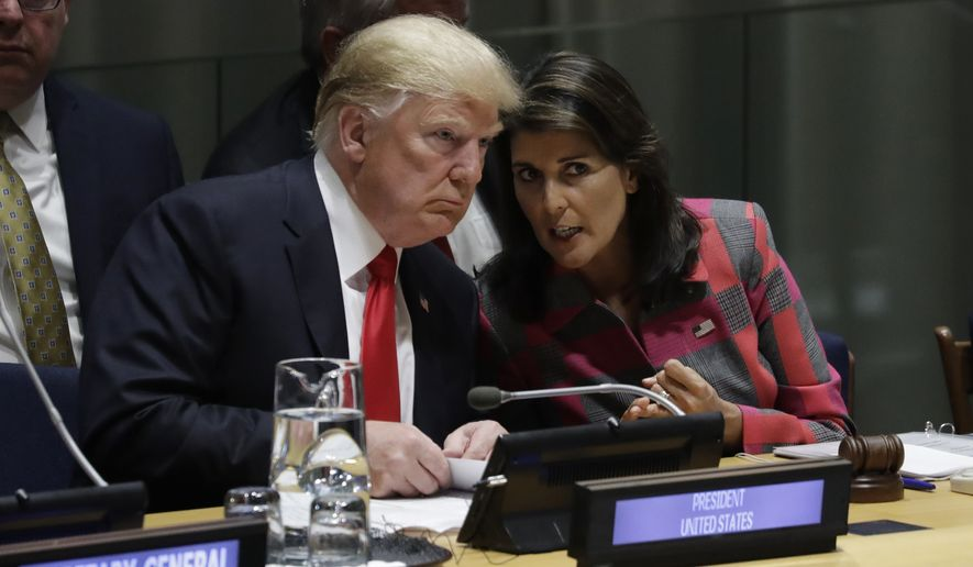President Donald Trump talks to Nikki Haley, the U.S. ambassador to the United Nations, at the United Nations General Assembly, Monday, Sept. 24, 2018, at U.N. Headquarters. (AP Photo/Evan Vucci)