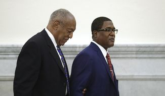 Bill Cosby is led from the courtroom during a break by his spokesman Andrew Wyatt at the Montgomery County Courthouse, during his sentencing hearing in Norristown, Pa., Monday, Sept. 24, 2018. (David Maialetti/The Philadelphia Inquirer via AP, Pool)