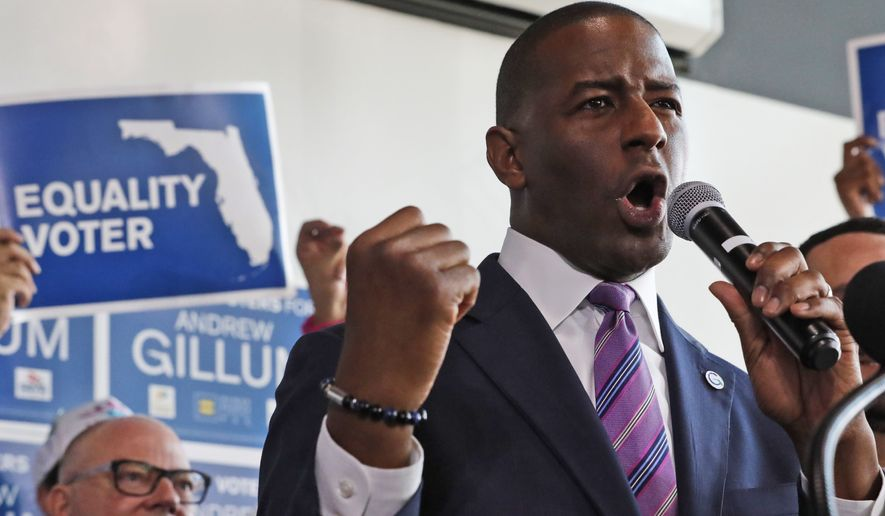 Florida Democratic gubernatorial candidate Andrew Gillum gestures as he speaks to members of Florida's lesbian, gay, bisexual, transgender and queer (LGBTQ) community, Monday, Sept. 24, 2018, in Miami. (AP Photo/Wilfredo Lee)