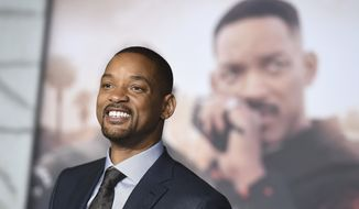 """In this Dec. 13, 2017, file photo, Will Smith arrives at the U.S. premiere of """"Bright"""" in Los Angeles. When Smith turns 50 on Tuesday, Sept. 25, 2018, he will jump head-first into the big milestone. The Fresh Prince plans to bungee jump from a helicopter over a gorge just outside Grand Canyon National Park. His birthday activity is the latest in a vast history of outrageous stunts staged in and around one of the worlds seven natural wonders. (Photo by Jordan Strauss/Invision/AP, File)"""