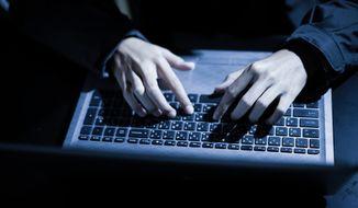 Hands on keyboard By NONWARIT / shutterstock.com