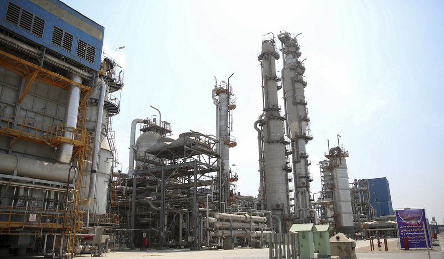 This Sept. 4, 2018, file photo, released by an official website of the Office of the Iranian Presidency, shows a part of the Pardis petrochemical complex facilities in Assalouyeh on the northern coast of the Persian Gulf, Iran. Bijan Zanganeh, Iran's oil minister, said the United States will not succeed in its plans to halt Iranian crude exports even as he acknowledged that South Korea has stopped buying oil from Tehran, Iranian media reported on Monday, Sept. 24, 2018. (Iranian Presidency Office via AP, File)