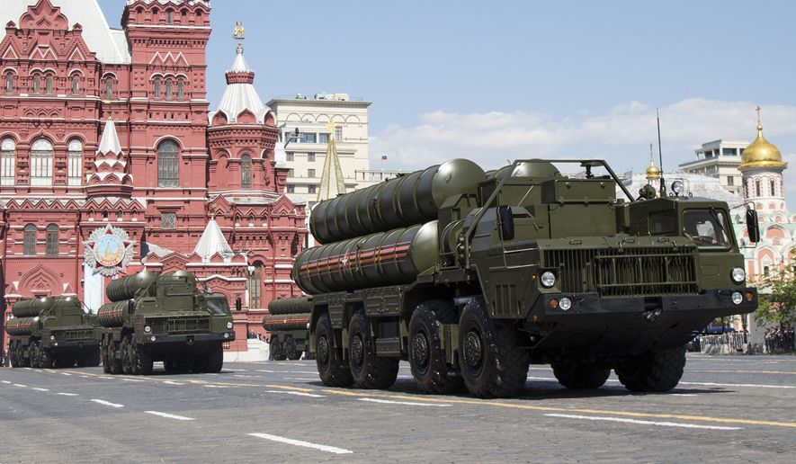In this file photo taken on Monday, May 9, 2016, Russian the S-300 air defense missile systems drive during the Victory Day military parade marking 71 years after the victory in WWII in Red Square in Moscow, Russia. Moscow will supply the Syrian government with modern S-300 missile defense systems following last weeks downing of a Russian plane, the Russian Defense Minister announced on Monday Sept. 24, 2018. (AP Photo/Alexander Zemlianichenko, File)