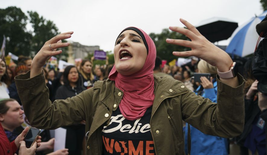 Linda Sarsour with Women's March calls out to other activists opposed to President Donald Trump's embattled Supreme Court nominee, Brett Kavanaugh, in front of the Supreme Court on Capitol Hill in Washington, Monday, Sept. 24, 2018. (AP Photo/Carolyn Kaster) ** FILE **
