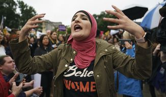 Linda Sarsour with Women's March calls out to other activists opposed to President Donald Trump's embattled Supreme Court nominee, Brett Kavanaugh, in front of the Supreme Court on Capitol Hill in Washington, Monday, Sept. 24, 2018. A second allegation of sexual misconduct has emerged against Judge Brett Kavanaugh, a development that has further imperiled his nomination to the Supreme Court, forced the White House and Senate Republicans onto the defensive and fueled calls from Democrats to postpone further action on his confirmation. President Donald Trump is so far standing by his nominee. (AP Photo/Carolyn Kaster)