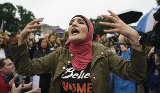 In this file photo, Linda Sarsour with Women's March calls out to other activists opposed to President Donald Trump's embattled Supreme Court nominee, Brett Kavanaugh, in front of the Supreme Court on Capitol Hill in Washington, Monday, Sept. 24, 2018. (AP Photo/Carolyn Kaster) ** FILE **