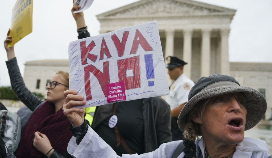 "A protester with a sign that reads ""KAVANO! I Believe Christine Blasey Ford"" calls out in front of the Supreme Court on Capitol Hill in Washington, Monday, Sept. 24, 2018. A second allegation of sexual misconduct has emerged against Judge Brett Kavanaugh, a development that has further imperiled his nomination to the Supreme Court, forced the White House and Senate Republicans onto the defensive and fueled calls from Democrats to postpone further action on his confirmation. President Donald Trump is so far standing by his nominee. (AP Photo/Carolyn Kaster)"