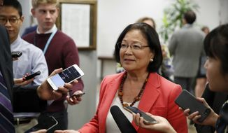"Sen. Mazie Hirono, D-Hawaii, center talks with reporters, on Capitol Hill, Monday, Sept. 24, 2018, in Washington. Denouncing his accusers for launching ""smears, pure and simple,"" Brett Kavanaugh said Monday he'll continue fighting for Senate confirmation to the Supreme Court, even as Republicans battled to prevent a second woman's assertion of a long-ago sexual assault from derailing his nomination. (AP Photo/Alex Brandon)"