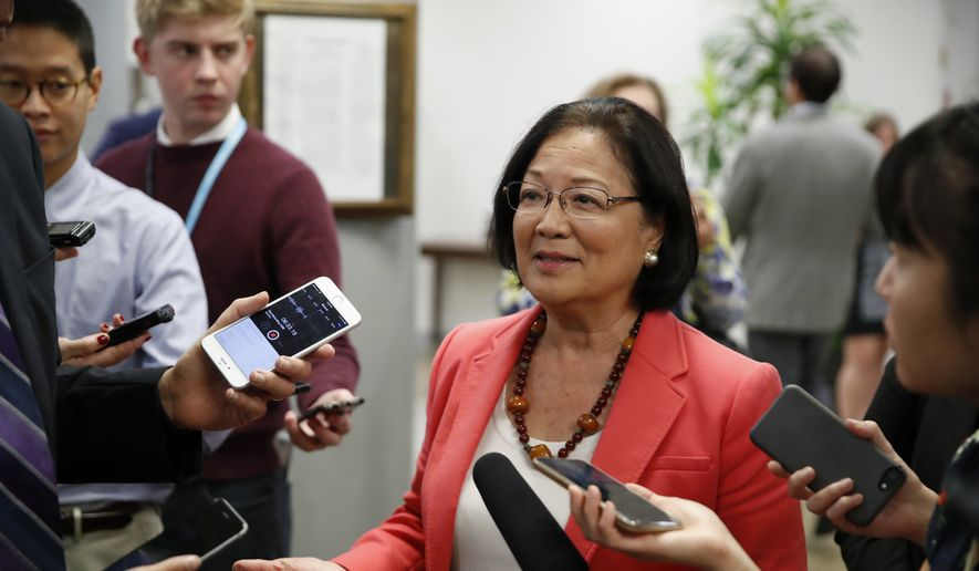 Sen. Mazie Hirono, D-Hawaii, center talks with reporters, on Capitol Hill, Monday, Sept. 24, 2018, in Washington. (AP Photo/Alex Brandon) ** FILE **