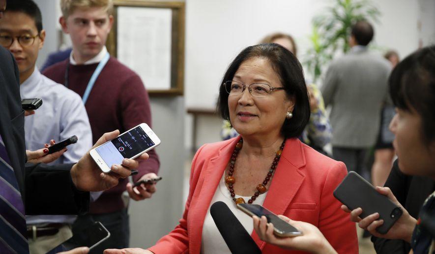 Sen. Mazie Hirono, D-Hawaii, center talks with reporters, on Capitol Hill, Monday, Sept. 24, 2018, in Washington. (AP Photo/Alex Brandon) ** FILE **