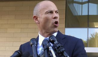 Michael Avenatti, attorney for porn actress Stormy Daniels, talks to reporters after a federal court hearing in Los Angeles, Monday, Sept. 24, 2018. (AP Photo/Amanda Lee Myers)
