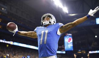 Detroit Lions wide receiver Marvin Jones looks towards the stands after scoring on a 33-yard pass reception during the second half of an NFL football game against the New England Patriots, Sunday, Sept. 23, 2018, in Detroit. (AP Photo/Rick Osentoski)