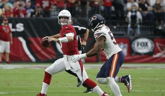 Arizona Cardinals quarterback Josh Rosen, left, looks to throw the ball as he is pressured by Chicago Bears linebacker Khalil Mack, right, during the second half of an NFL football game, Sunday, Sept. 23, 2018, in Glendale, Ariz. (AP Photo/Rick Scuteri) **FILE**