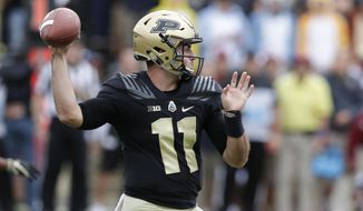 Purdue quarterback David Blough (11) throws against Boston College during the first half of an NCAA college football game in West Lafayette, Ind., Saturday, Sept. 22, 2018. (AP Photo/Michael Conroy)
