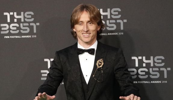 Croatia's Luka Modric, nominee for the Best FIFA Men's Player award, arrives for the ceremony of the Best FIFA Football Awards in the Royal Festival Hall in London, Britain, Monday, Sept. 24, 2018. (AP Photo/Frank Augstein)