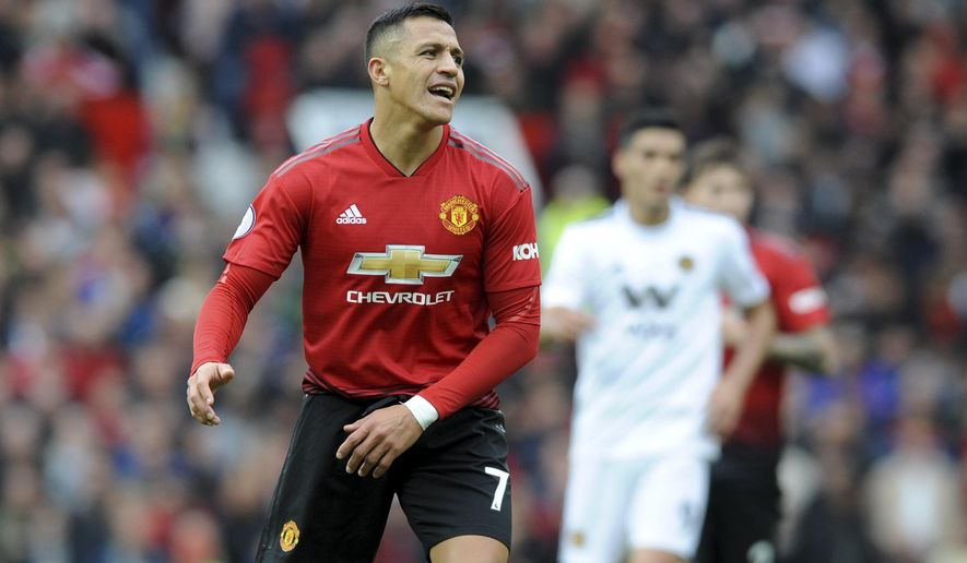 Manchester United's Alexis Sanchez reacts during the English Premier League soccer match between Manchester United and Wolverhampton Wanderers at Old Trafford stadium in Manchester, England, Saturday, Sept. 22, 2018. (AP Photo/Rui Vieira)