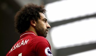 Liverpool's Mohamed Salah looks on,  during the English Premier League soccer match between Liverpool and Southampton, at Anfield, in Liverpool, England, Saturday, Sept. 22, 2018. (Dave Thompson/PA via AP)