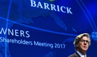 In this April 25, 2017 photo, Barrick Gold executive chairman of the board John L. Thornton speaks during the company's annual general meeting in Toronto. Barrick Gold has agreed to buy Randgold Resources for $6.1 billion in stock to create the world's largest gold miner, worth a combined $18 billion. (Nathan Denette/The Canadian Press via AP)