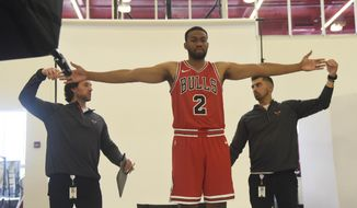 Chicago Bulls' Jabari Parker (2) has his reach measured by Dave Zarzynski, left, and Jimmy Mitchell during media day at the NBA basketball team's facility Monday, Sept. 24, 2018, in Chicago. (AP Photo/David Banks)